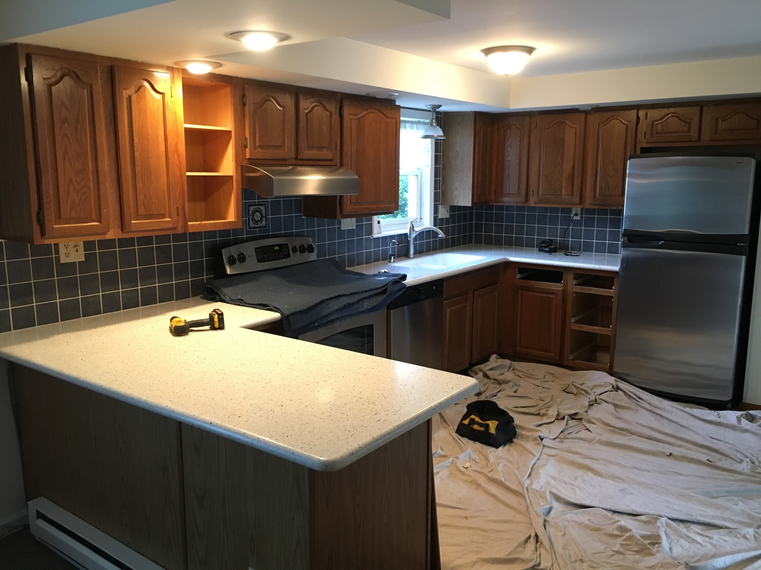 cost cabinets and before refacing the kitchen after
