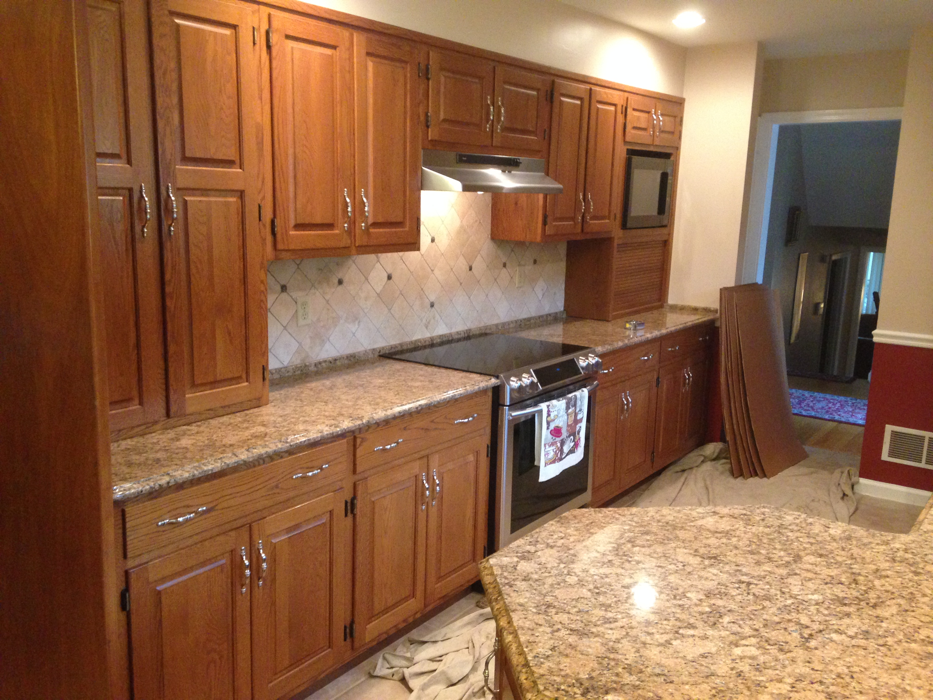 Refacing dated oak to elegant cherry capital kitchen for Oak kitchen cabinet refinishing